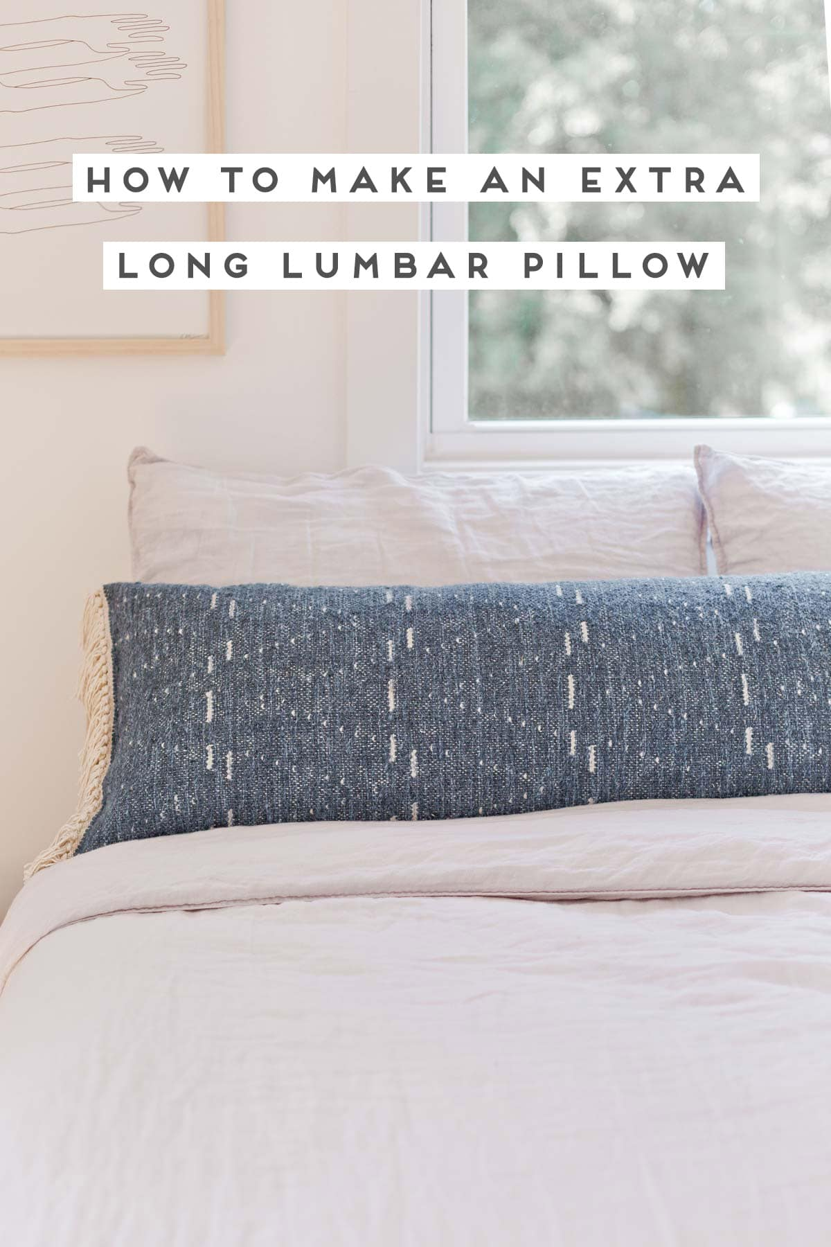 Extra long lumbar pillow in neutral bedroom, with linen bedding.