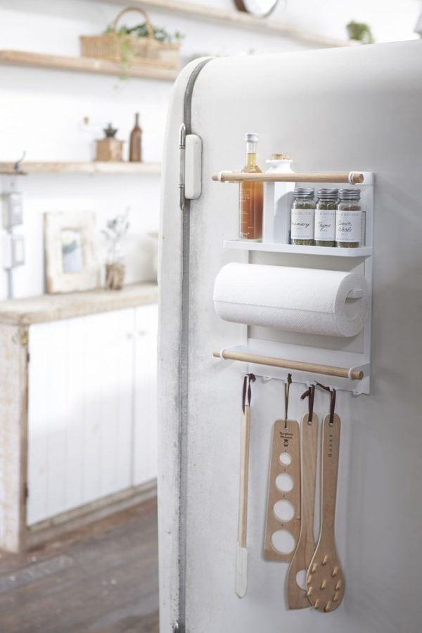 One of the most overlooked places for added storage is the back of the door and the side of the fridge. Adding hanging shelves or towel racks, etc to these areas can help cut down on clutter, especially in the smallest of spaces. #organization #kitchen
