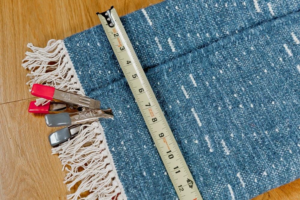 Measuring rug to create an extra long lumbar pillow.