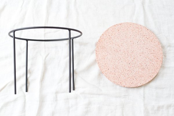 How to make a unique modern side table with loads of style (It's terrazzo). Click through for the tutorial and all the sources you'll need to make your own. #sidetable #diyhome #diydecor #diyfurniture #weekendproject #pinkhomedecor
