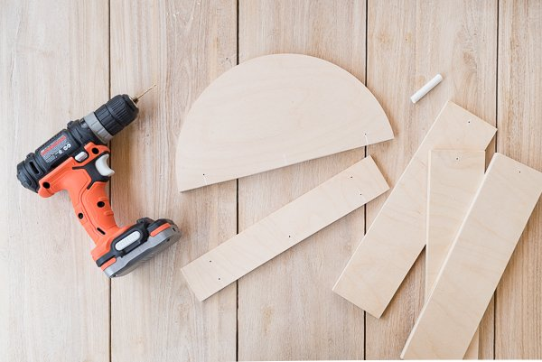 DIY Modern Wood Wall Hanging! Step 3: Drill tiny holes in cut wood pieces for the wire. #diy #diyart #wallhanging #wood