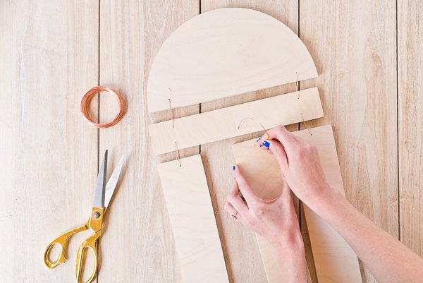 DIY Modern Wood Wall Hanging! Step 4: Attach all wood pieces with copper wire. #diy #diyart #wallhanging #wood