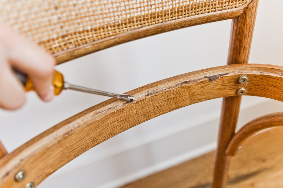 Reupholstery Step 2: Remove any glue or residue from the previous seat cushion. #reupholstery #diy #chairs #diningchairs #diyfurniture