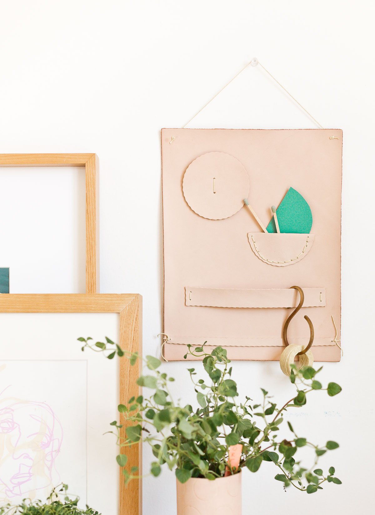 DIY Wall Organizer. Make a unique leather wall organizer for back to school and beyond. Great for all workspace (or craft space). #diy #leatherdiy #organizer #wallorganizer #backtoschool #diynotebook #leather