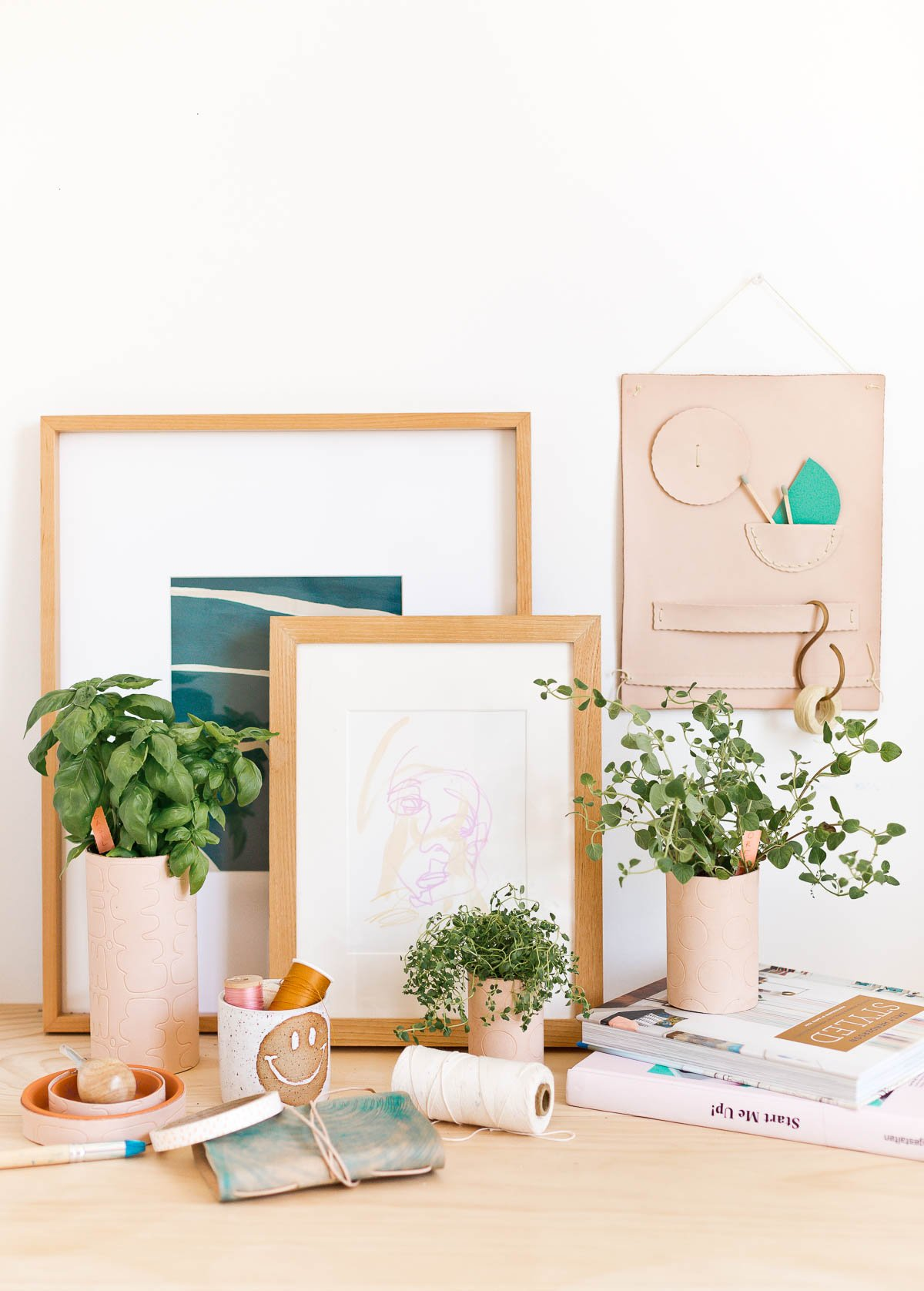 3 DIY ways to use leather to make unique items you'll actually use. Make a DIY leather wall organizer, DIY leather planters, and a DIY leather notebook. Click through for all three tutorials. #leather #diy #leatherdiy #homedecor #workspace #desk #indoorherbgarden #polkadot #herbs