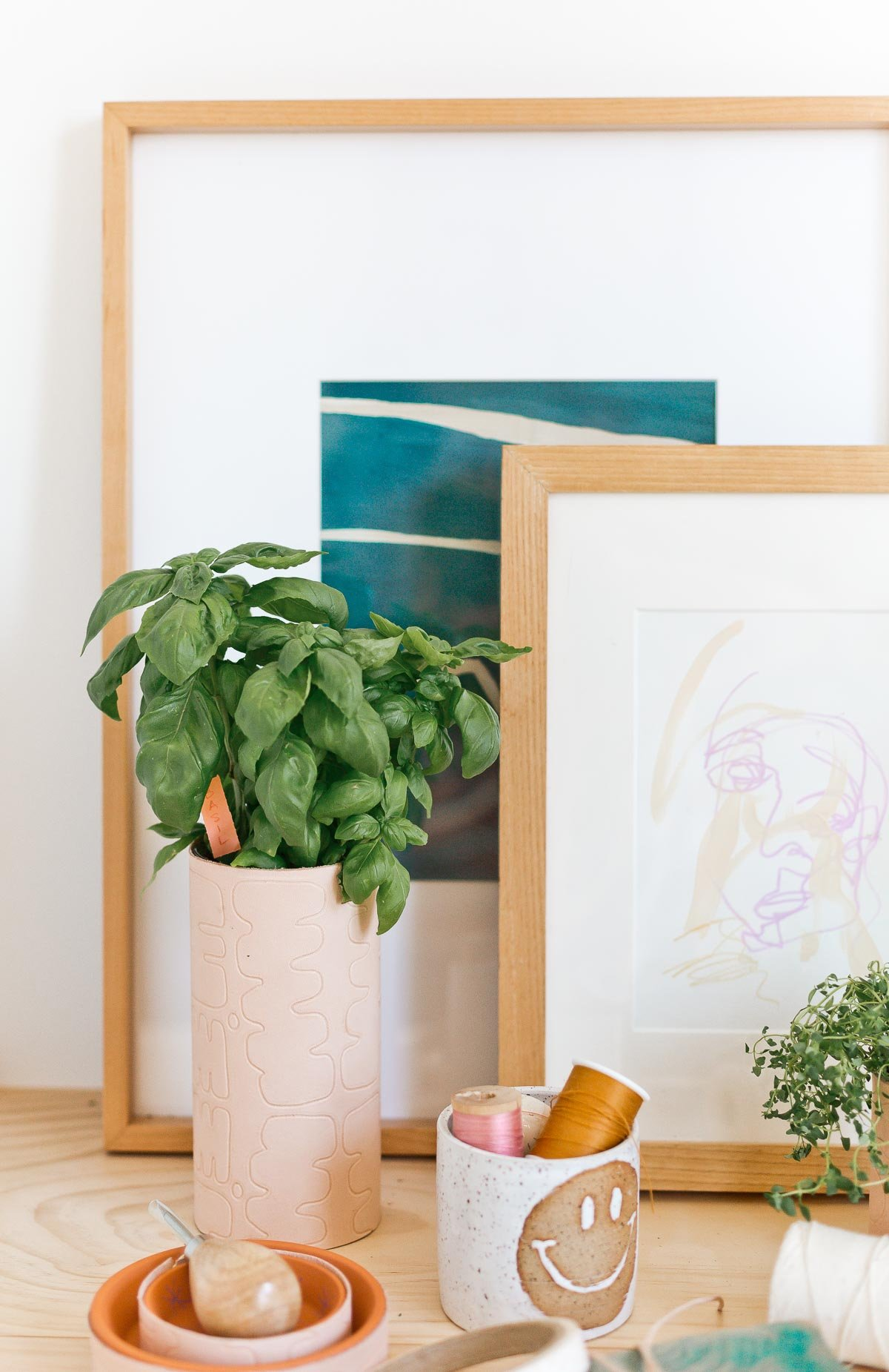 Make a chic indoor herb garden with DIY embossed leather planters that utilize a surprising pantry item. Looks cute on a windowsill or even on your desk. #leather #diy #leatherdiy #homedecor #workspace #desk #indoorherbgarden #polkadot #herbs