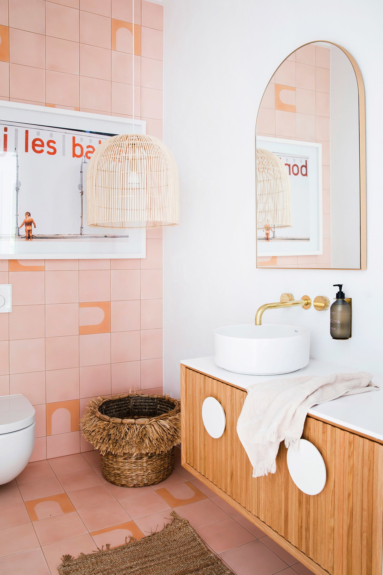 Look at this bathroom from Three Bird Renovations. The tile, the mirror, the light fixture? It's all so good. #arch #designtrend #interiors #organicmodern #bathroom #archmirror #pinktile #pinkbathroom #modernbathroom