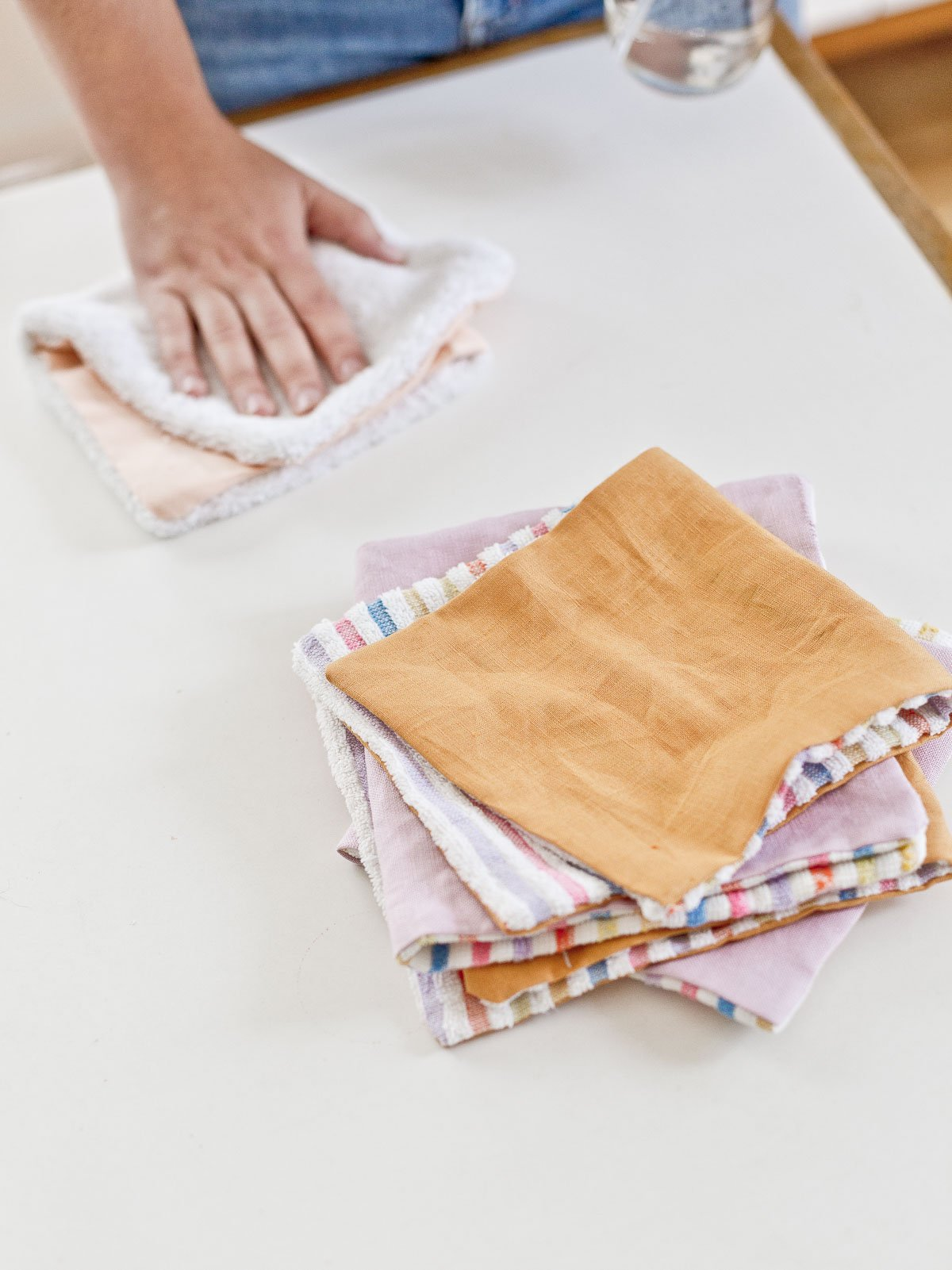 Cleaning up spills with simple DIY unpaper towels made of colorful fabric scraps.