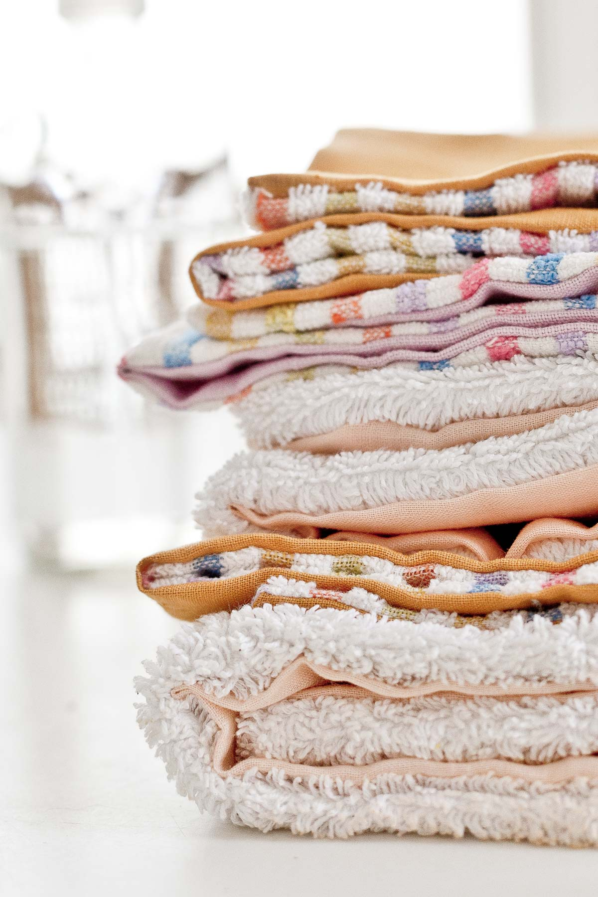 Stacked DIY unpaper towels using colorful fabric scraps and terrycloth.