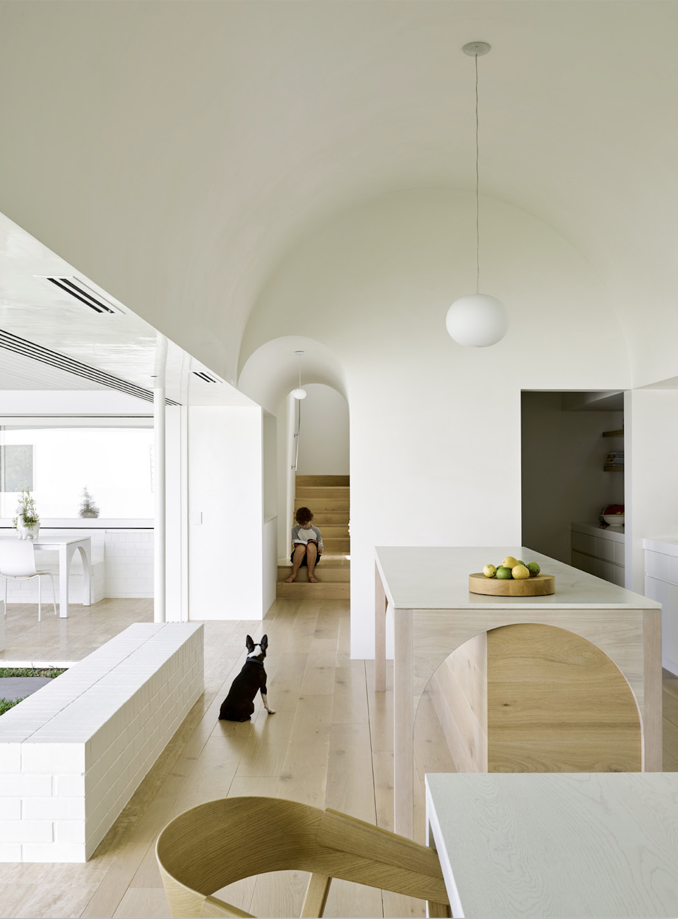 Arched doorway, arched ceiling, arched island, oh my! This space from Hogg and Lamb really embraces the arched trend in several places...there's even an arch detail over at the dining room table.  #arch #designtrend #interiors #organicmodern #kitchen #whitekitchen #minimalkitchen #minimalinterior
