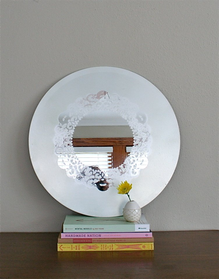 DIY Idea! Learn how to make a frosted glass mirror with a doily design pattern.