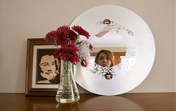 Learn how to make a frosted glass mirror with a doily design pattern.