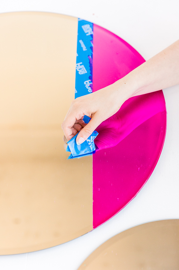 Removing tape after color blocking a mirror with special paint.