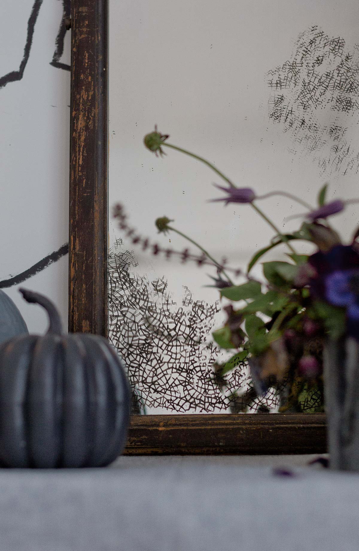Detail photo of antique stenciled mirror for Halloween.