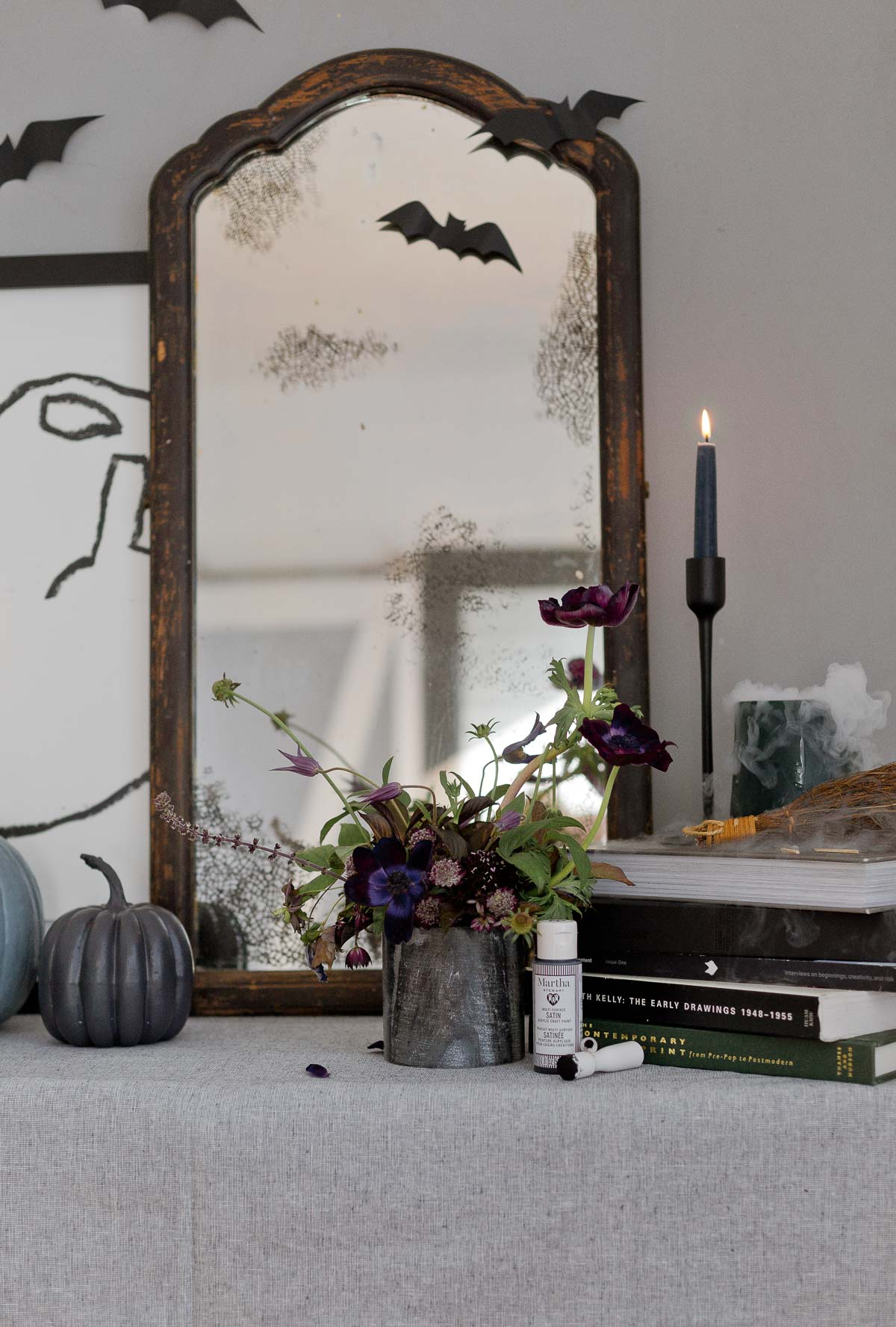 A modern take on Halloween decor with an antique DIY mirror, painted pumpkins, and more.