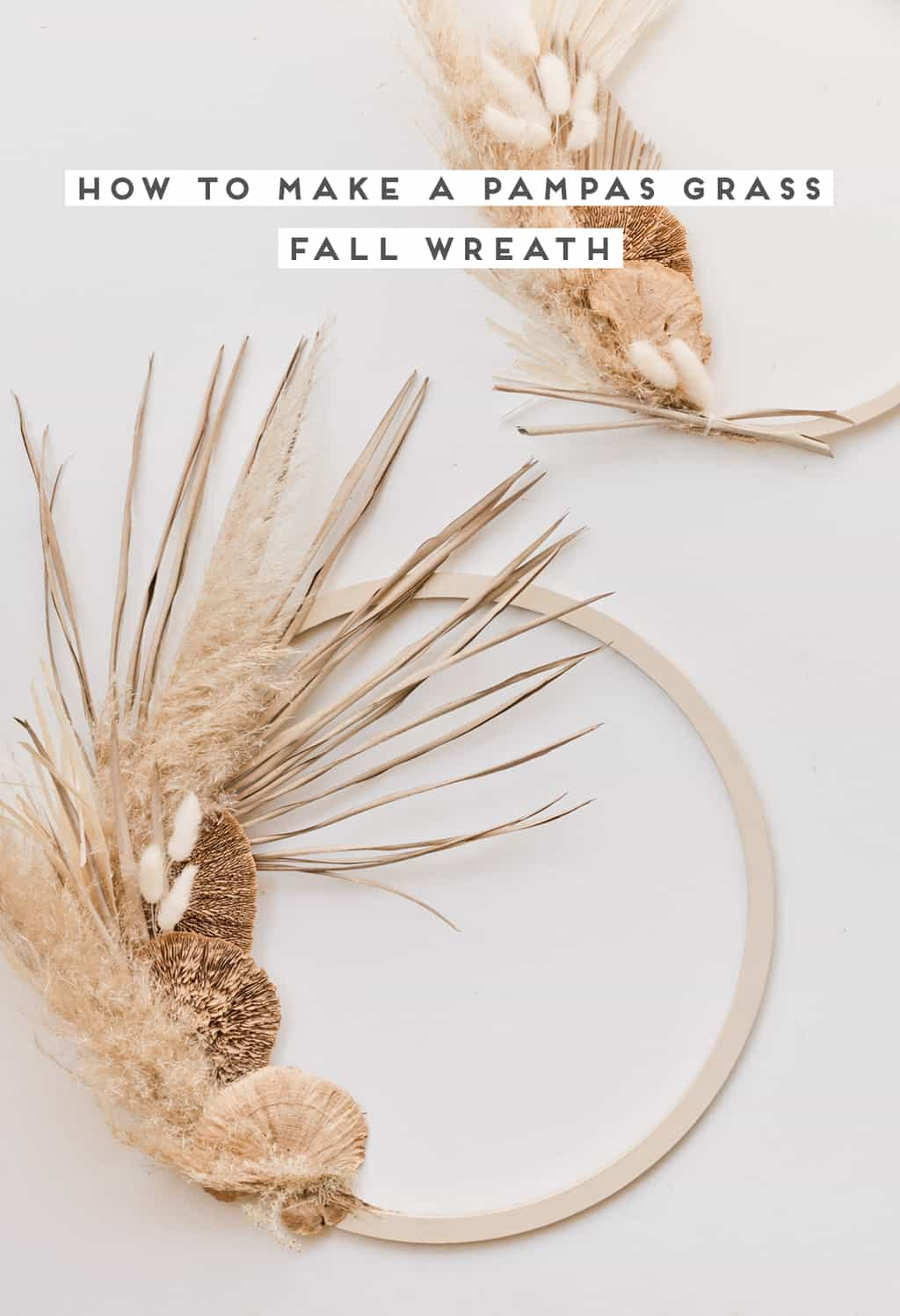 An image of papa grass and dried floral fall wreaths.