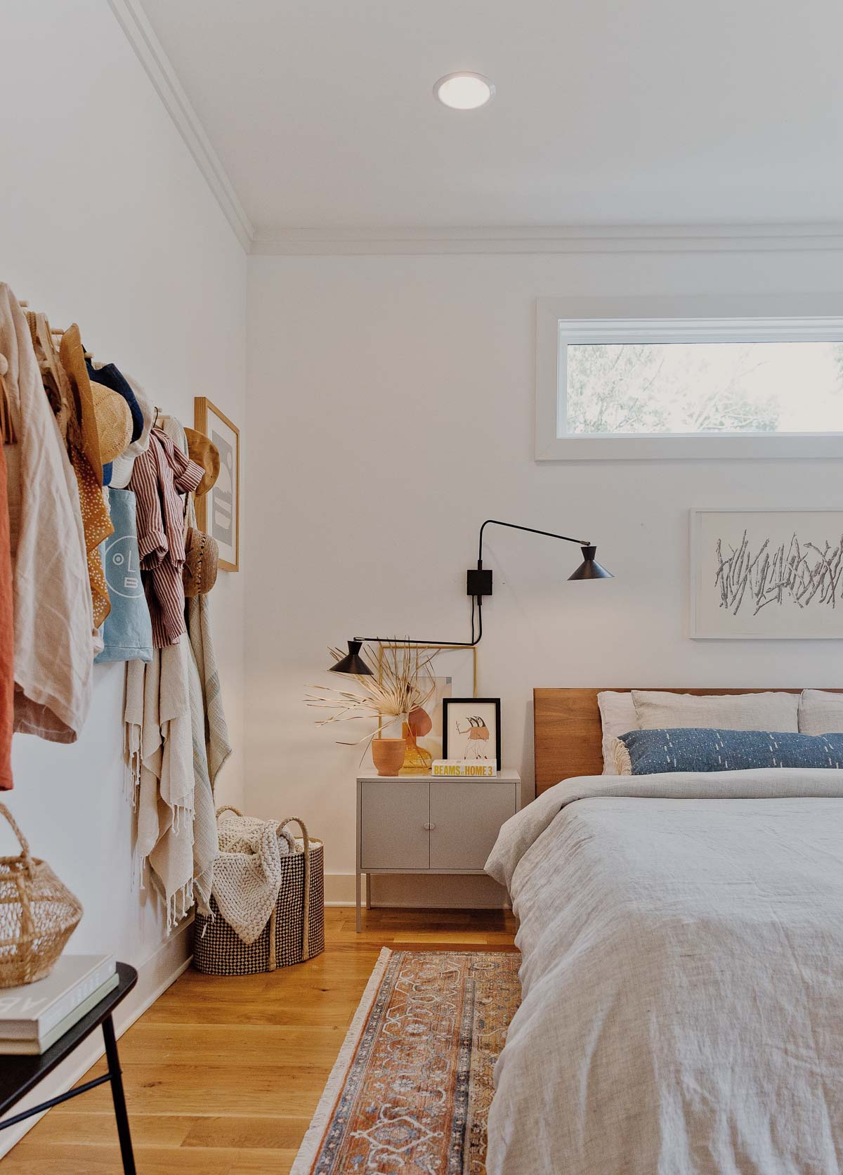Simple modern bedroom with earthy colorful accessories.