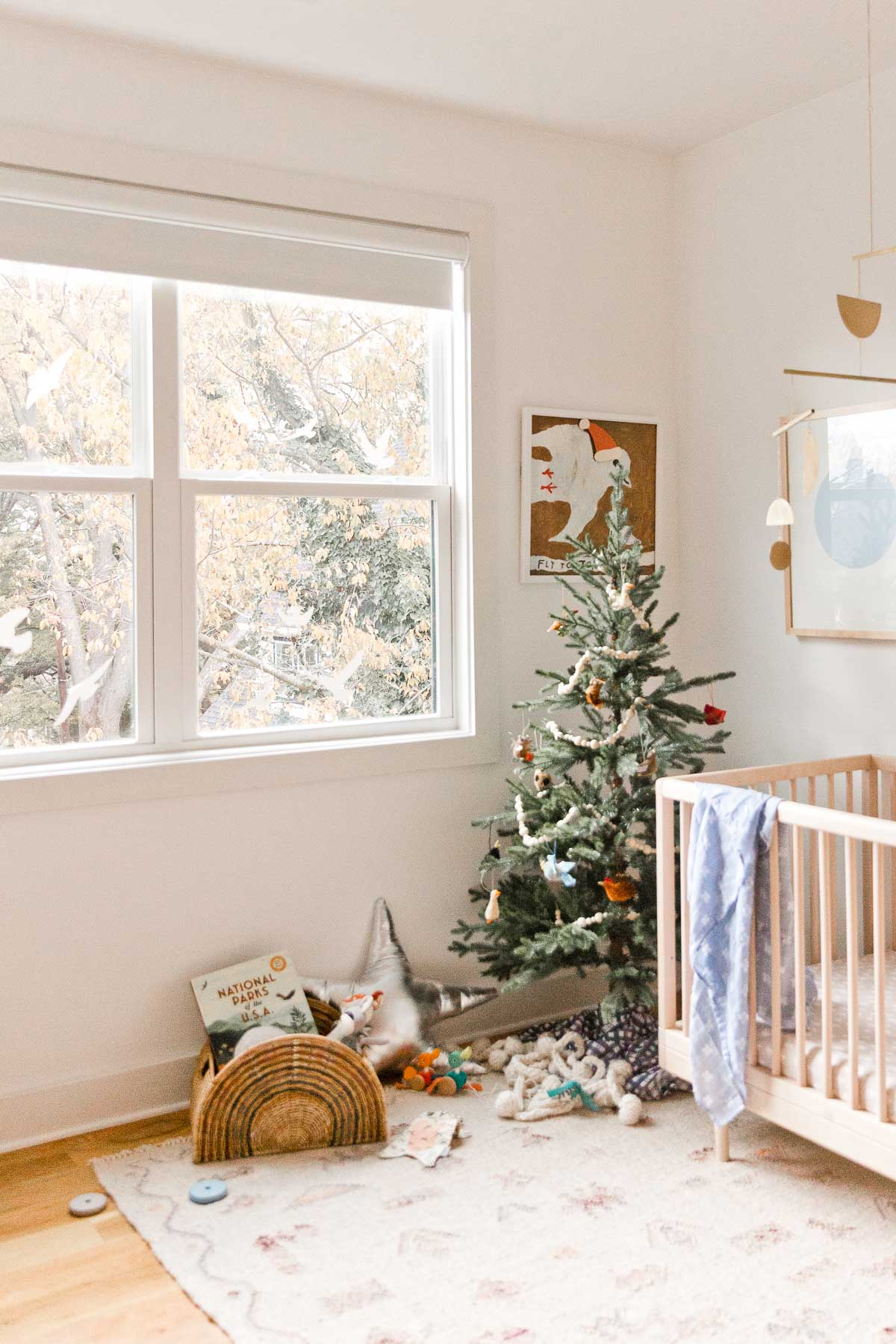 Holiday decorating in a kids room - with a Christmas tree and metallic star pillows.