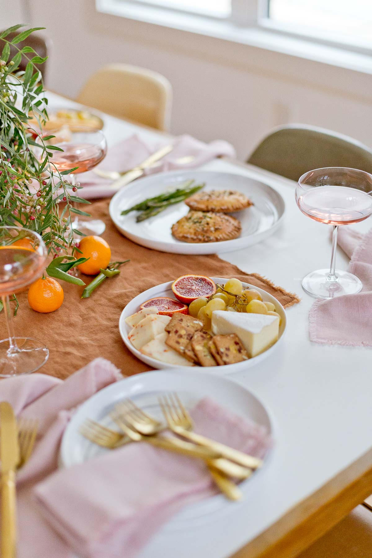 Holiday dinner tablescape closeup with holiday foods and wine