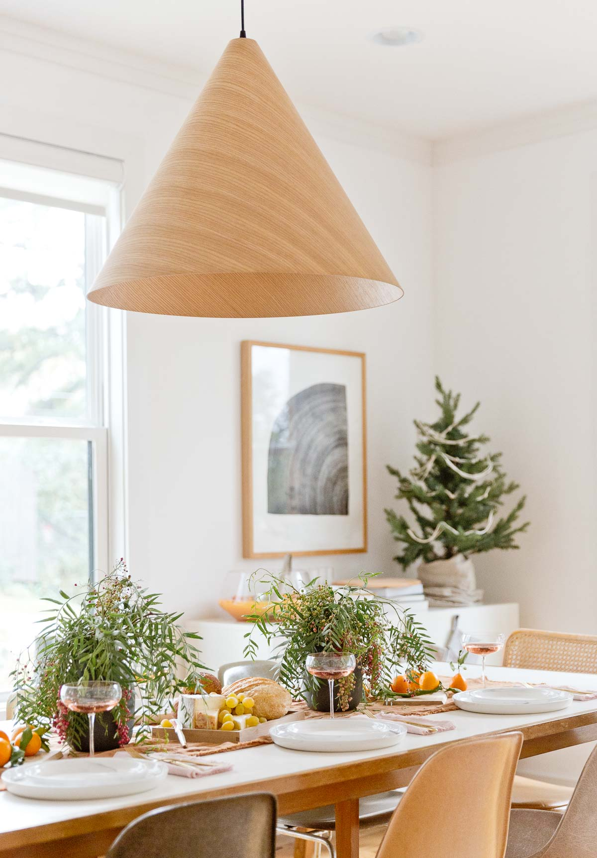 Holiday decor on a simple mid-century dining table