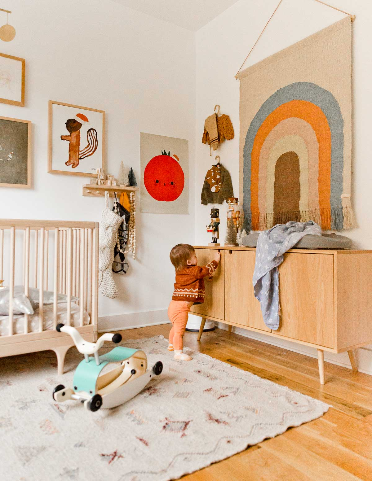 A gender-neutral nursery / kid's room gets an upgrade for the holidays (and beyond). Look at that rainbow wall hanging!