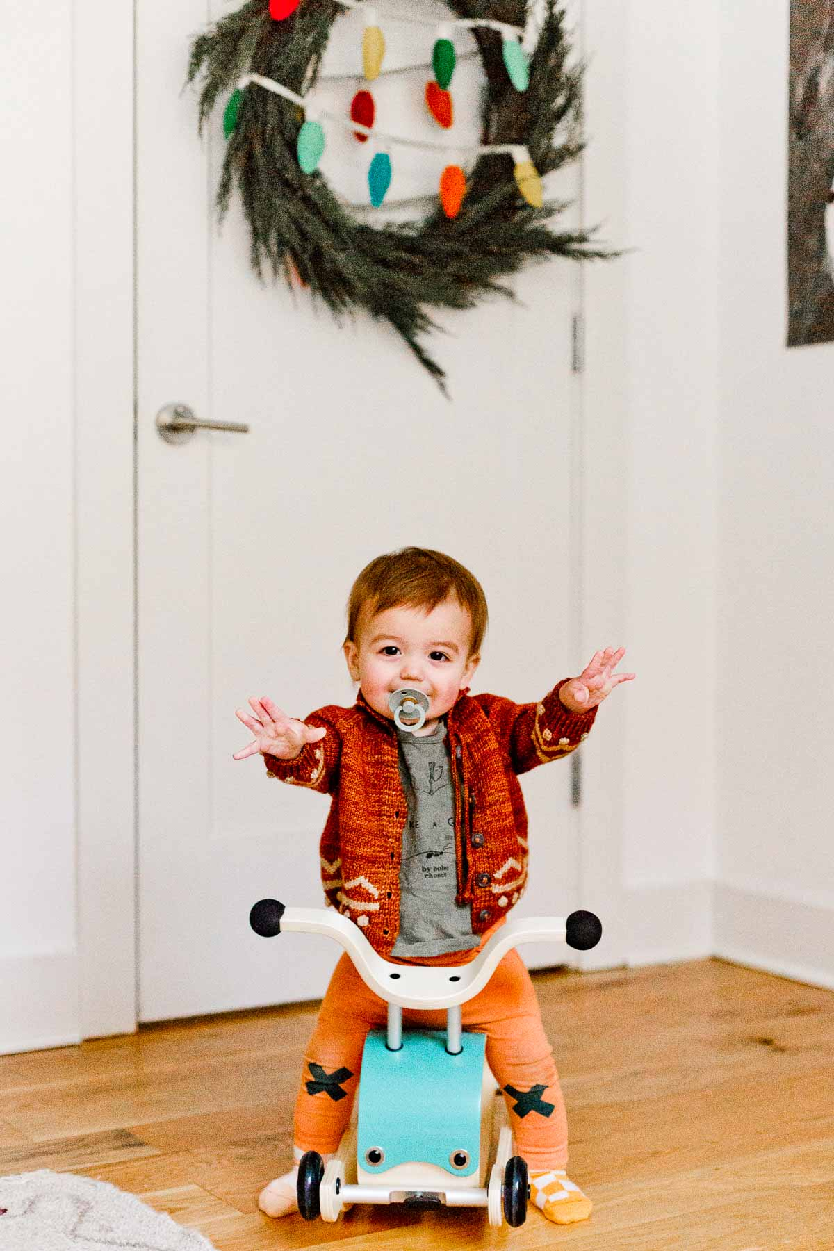 Toddler on big shaped ride on toy - holiday gift ideas.