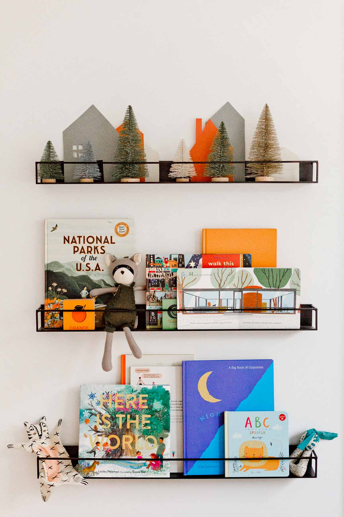 A holiday inspired bookshelf for kids. The DIY paper village and bottle brush trees are a cute touch.