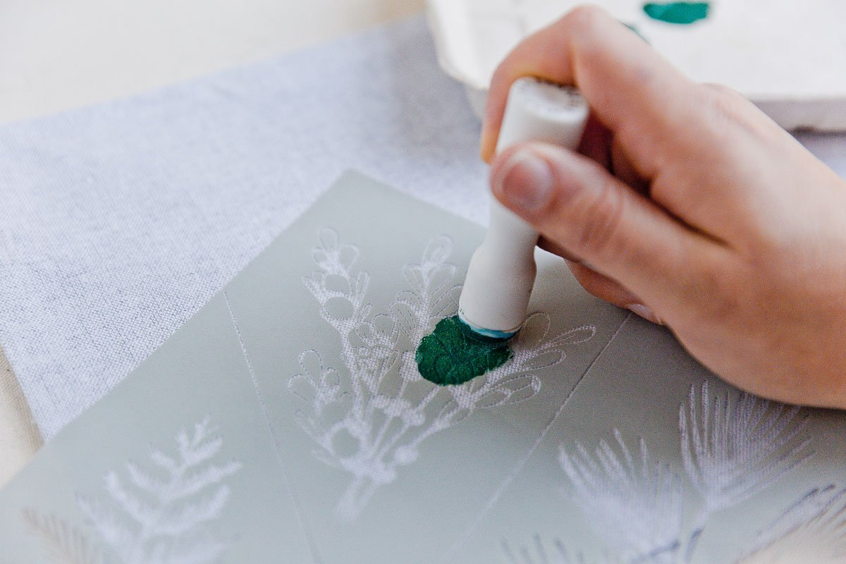 Daub paint over the surface to create a stenciled design