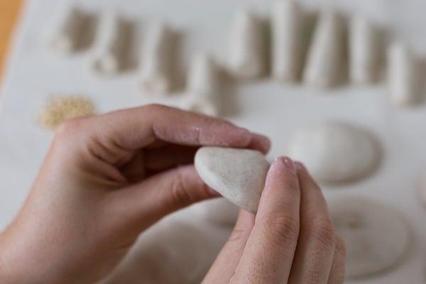 Push ball with thumbs to create mushroom cap shape