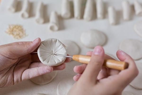 Create ridges on the underside of the clay mushroom cap