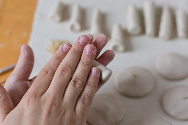 Roll out mushroom stem with clay between your fingers