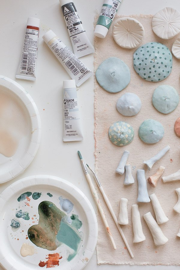 Paint clay mushroom pieces once dry