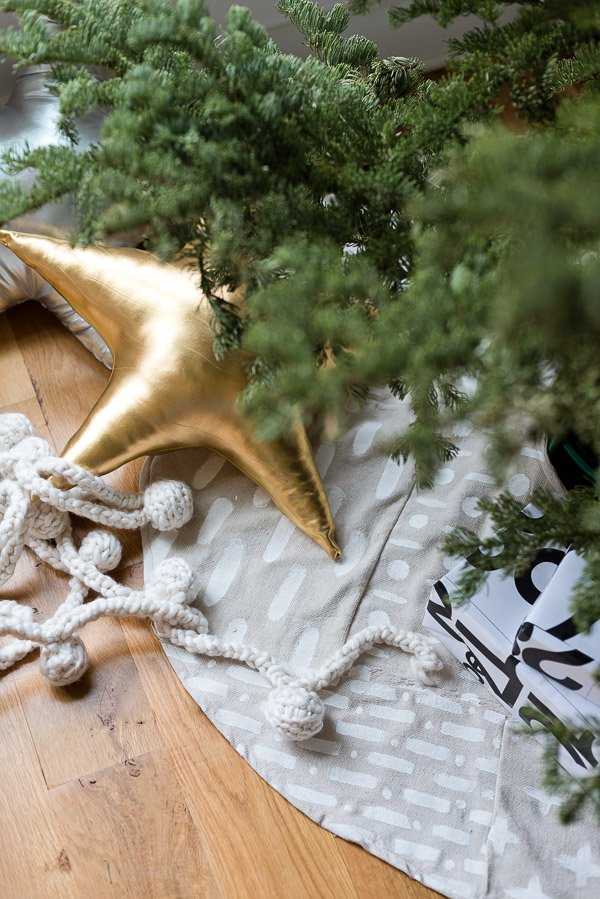 Hand painted DIY mud cloth tree skirt idea for Christmas