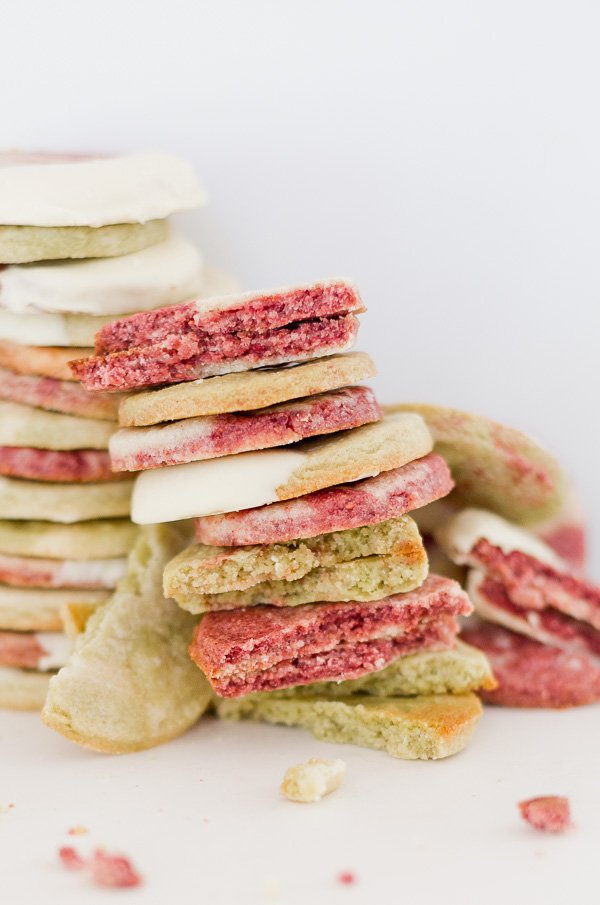 Stacked homemade sugar cookies in red and green (without using food coloring)