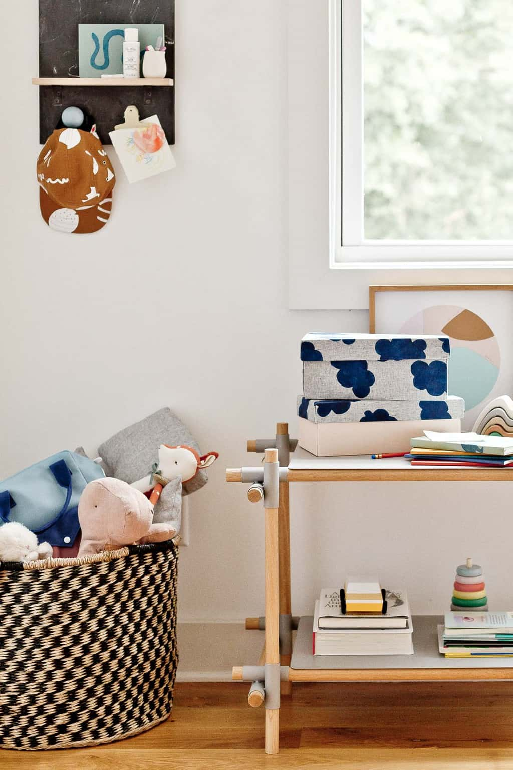 Kid's room with fabric covered storage boxes and large baskets for toys