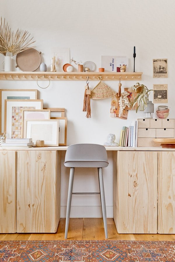 Image of a DIY standing desk made of wood cabinets and a wood table top.