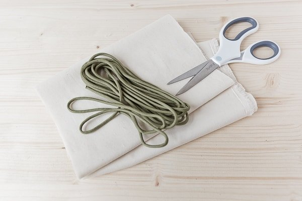 Materials for reusable produce bags: scissors, cord, muslin