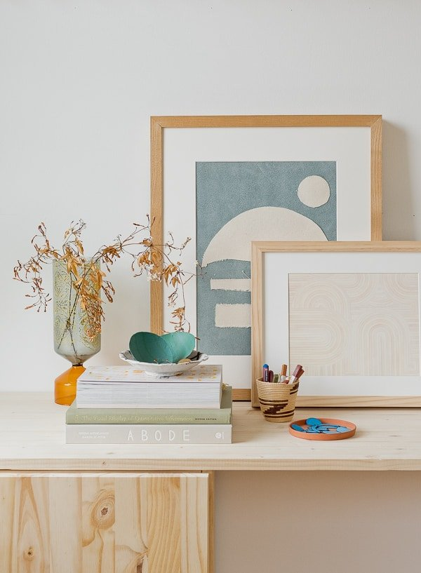 Simple abstract artwork resting on a wood desk