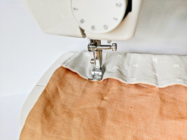 Finishing the sewing process for DIY fabric roll.