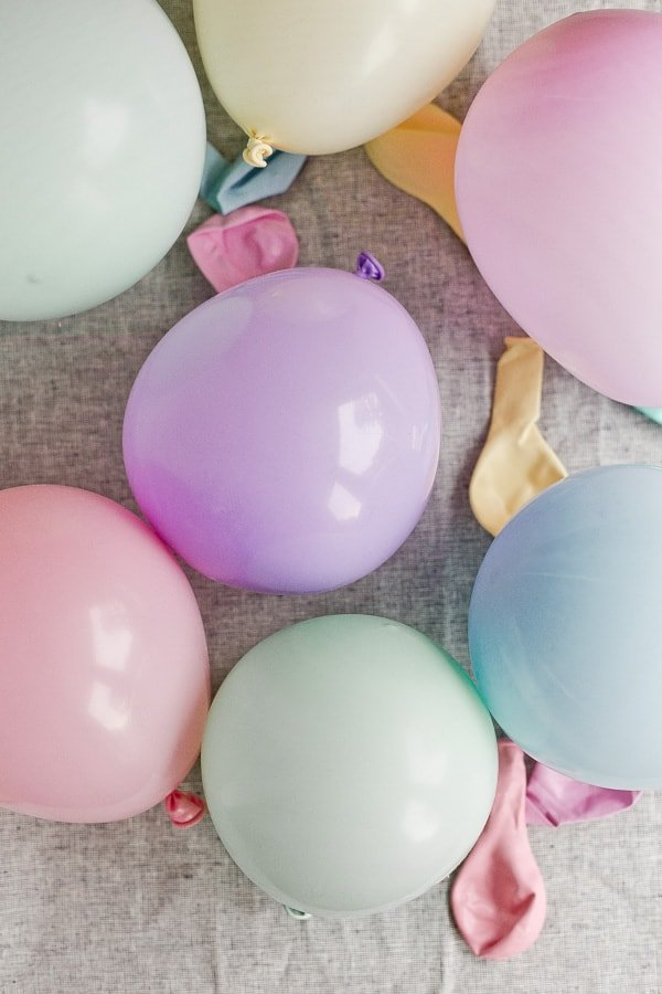 Colorful pastel balloons blown up on table.