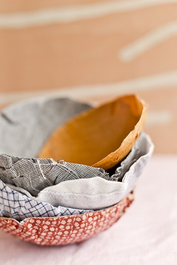 Stacked fabric bowls in various neutral colors.