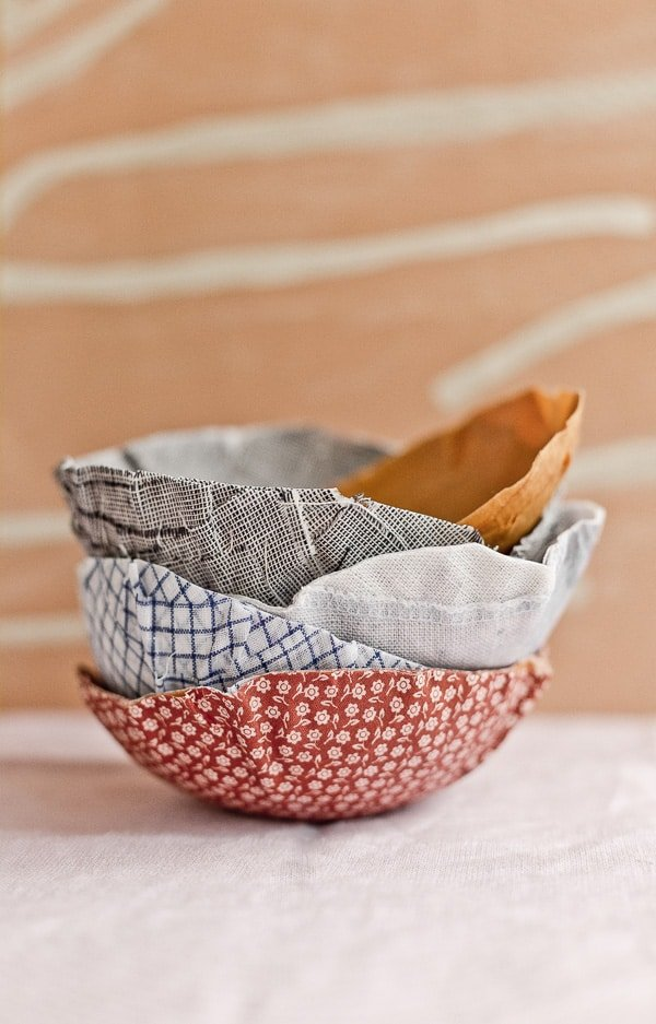 Stacked fabric bowls in various patterns and colors.