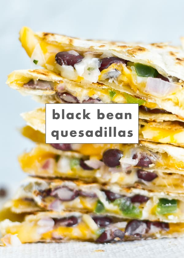 Image of cheesy black bean quesadillas on a plate, stacked up together.