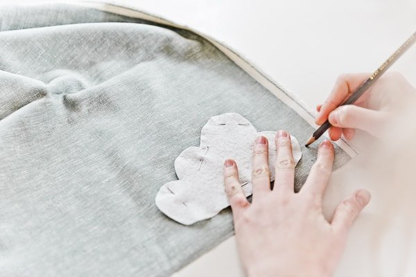 Making stuffed toy and tracing cloud onto fabric.