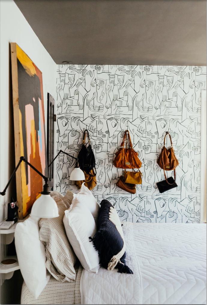 Hand wallpaper in bedroom