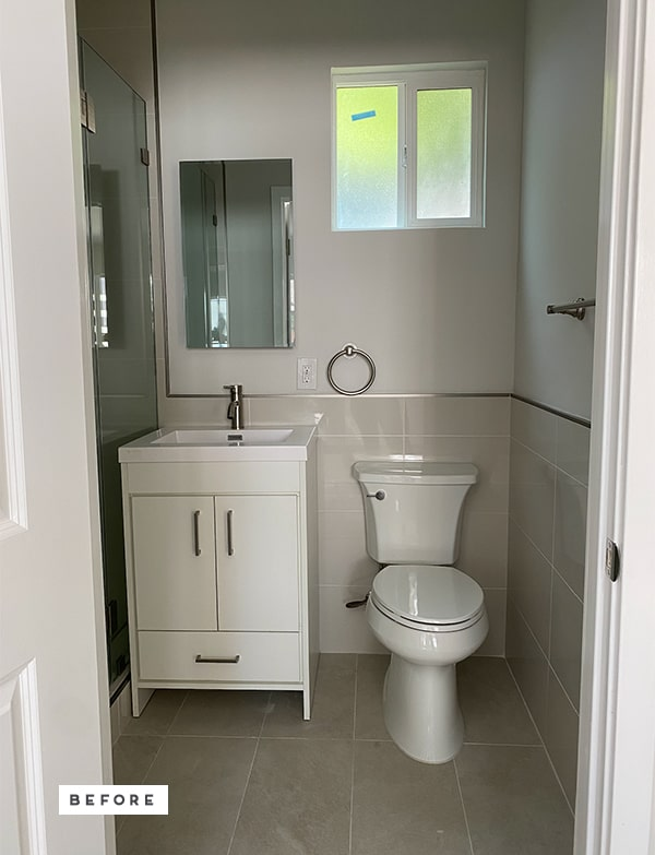 Photo of basic, neutral, small renter's bathroom.