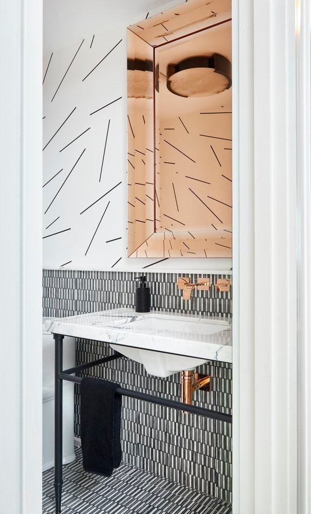 A modern, minimal black and white patterned bathroom.