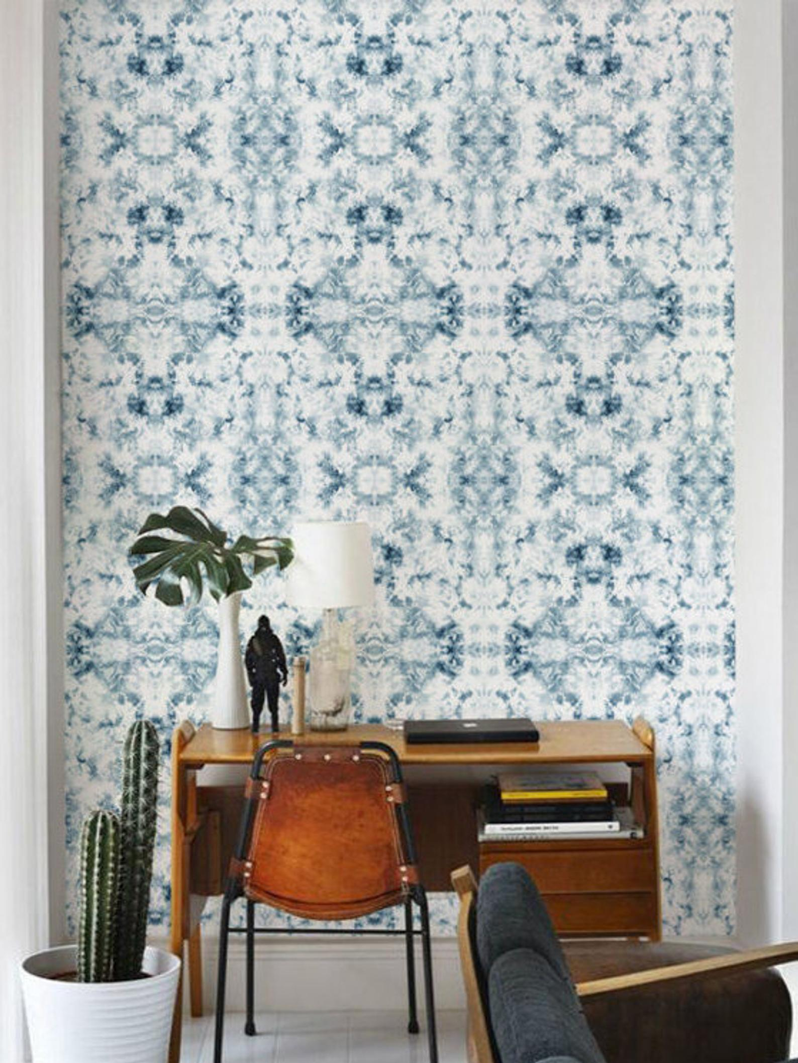 Abstract blue and white pattern wallpaper in a mid-century inspired room.