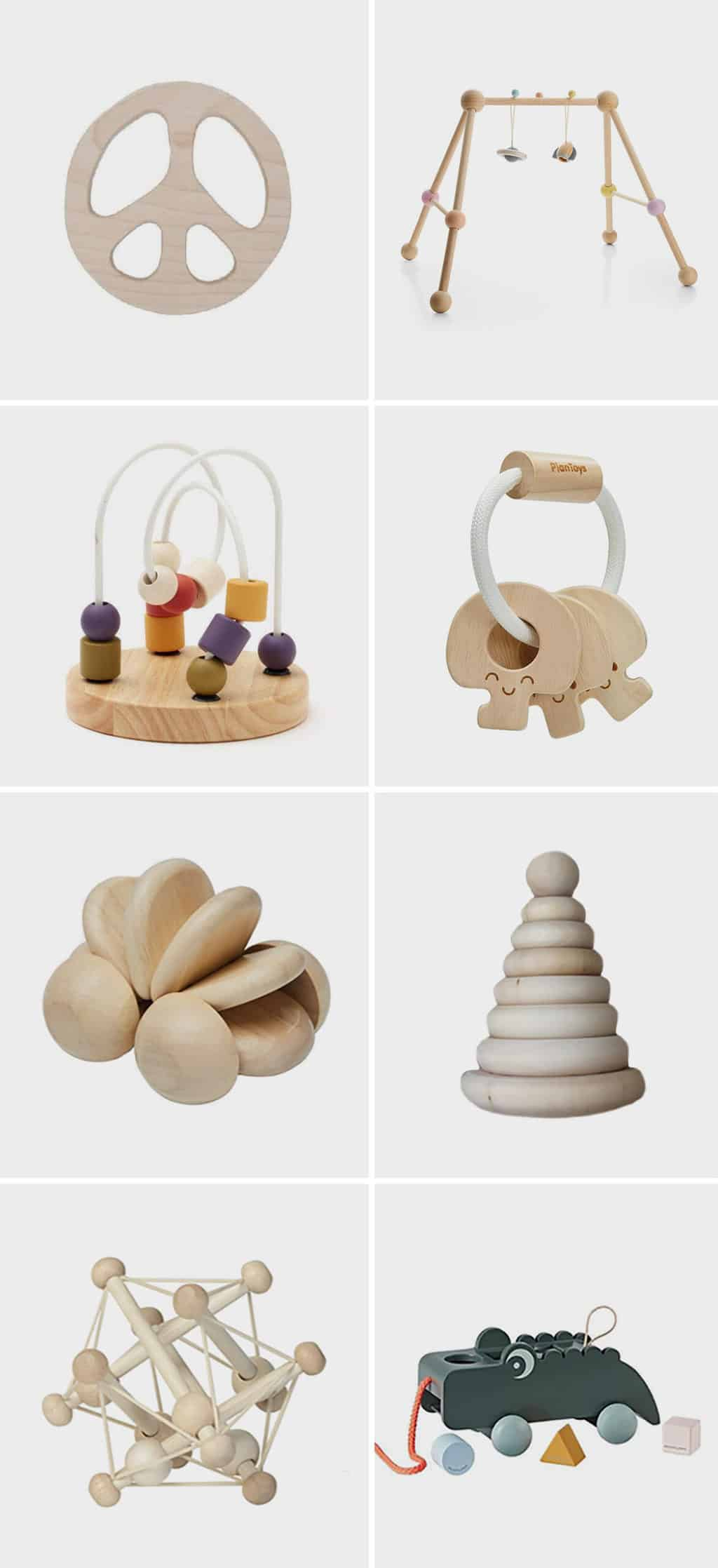 Image of various wooden toys for babies, featuring a peace sign teether, wooden play gym, wooden keys, and more.