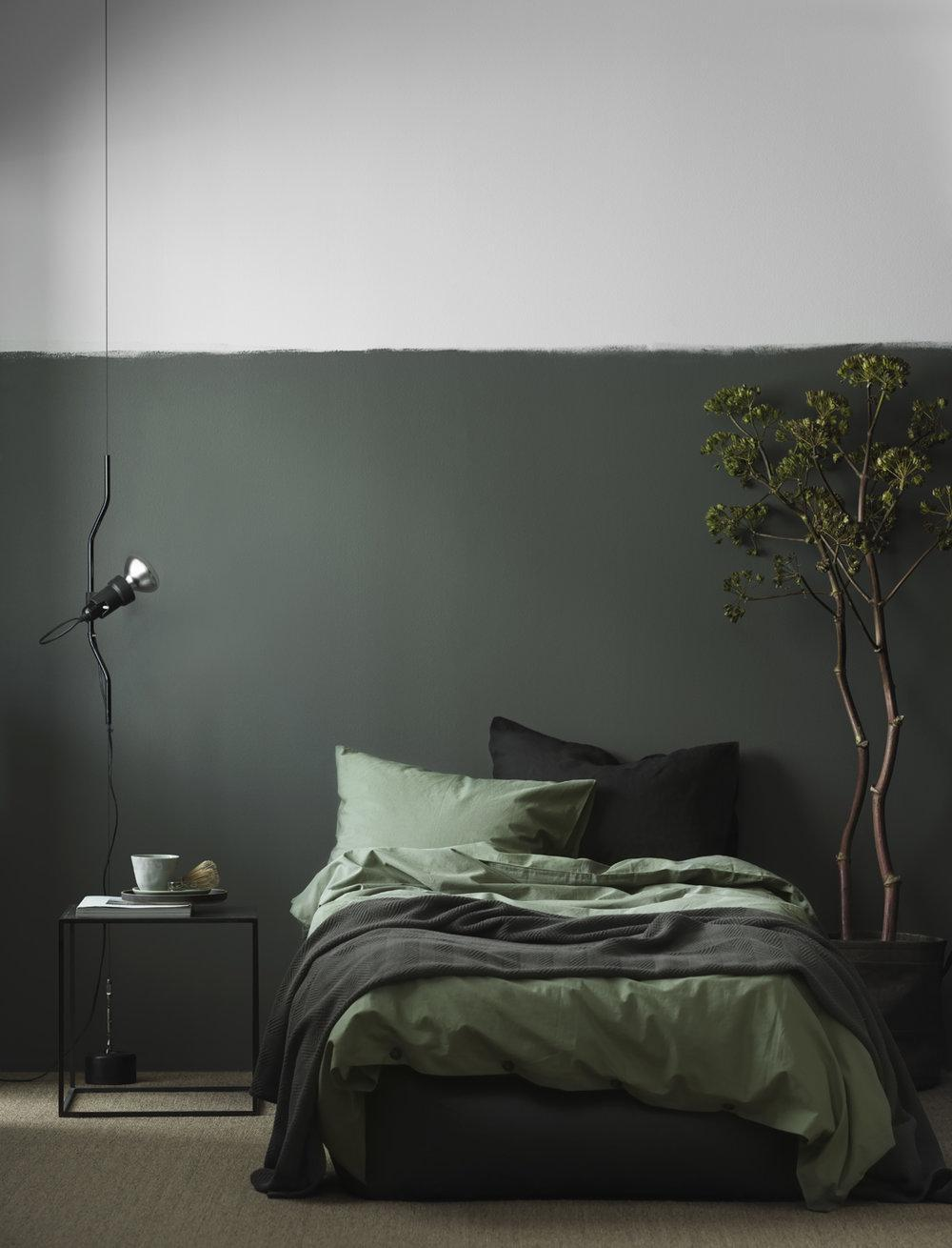 A monochromatic green bedroom inspired by nature.